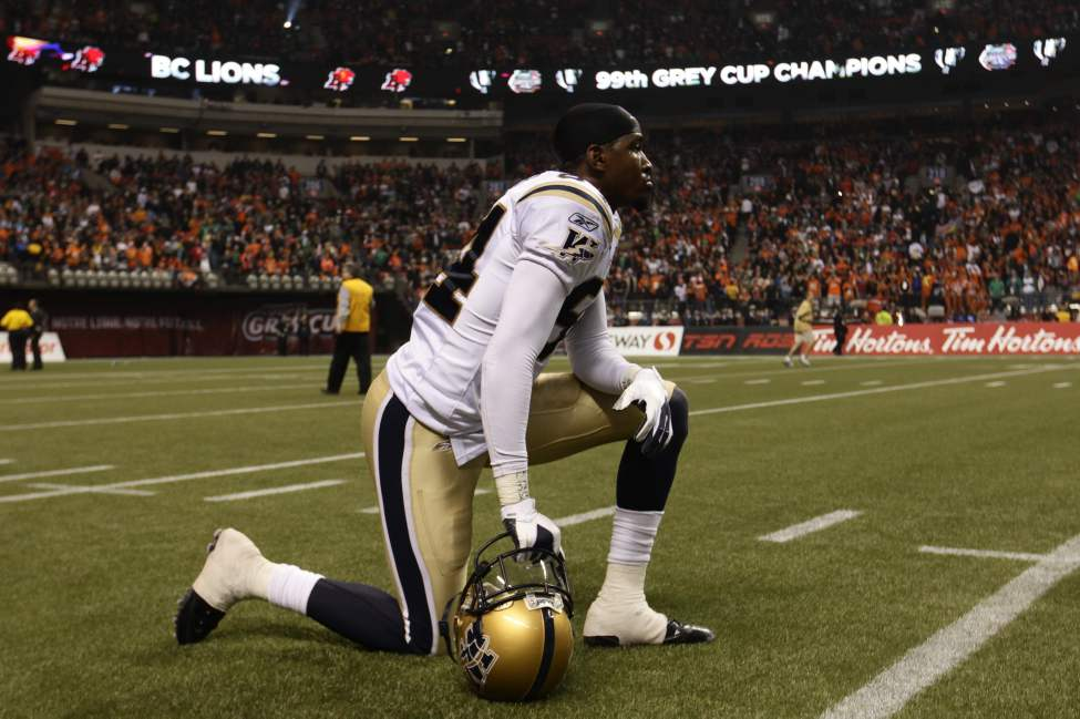 Winnipeg Blue Bombers defensive lineman Deji Oduwole kneels on the field following his team's defeat to the B.C. Lions in the  99th CFL Grey Cup Sunday November 27, 2011 in Vancouver. 