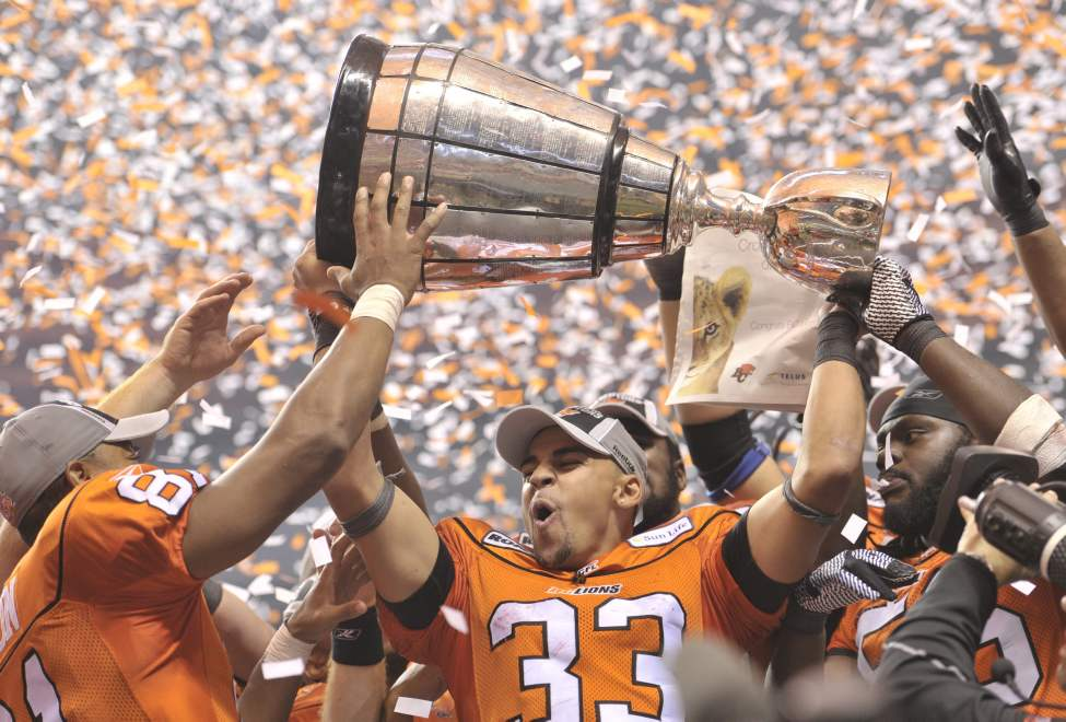 B.C. Lions Andrew Harris hoists the Grey Cup after beating the Winnipeg Blue Bombers 34-23 in the  99th CFL Grey Cup. (THE CANADIAN PRESS/Nathan Denette)