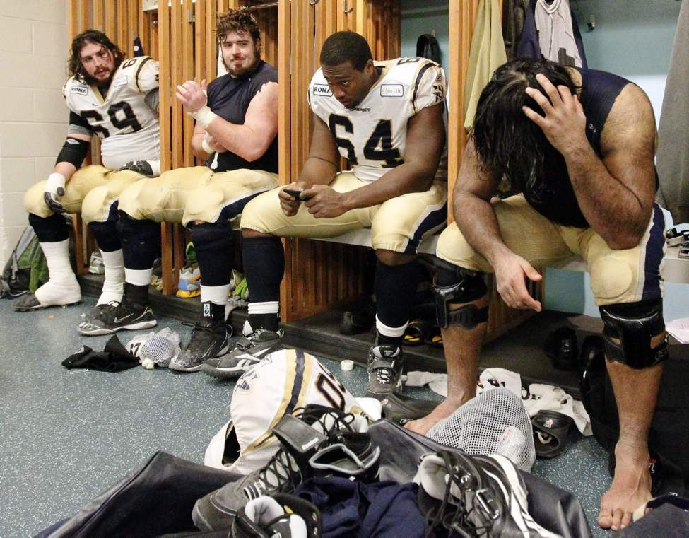 Winnipeg Blue Bombers sit dejected in their locker room after their loss at the 2011 Grey Cup final to the B.C. Lions.   (John Woods  / Winnipeg Free Press)