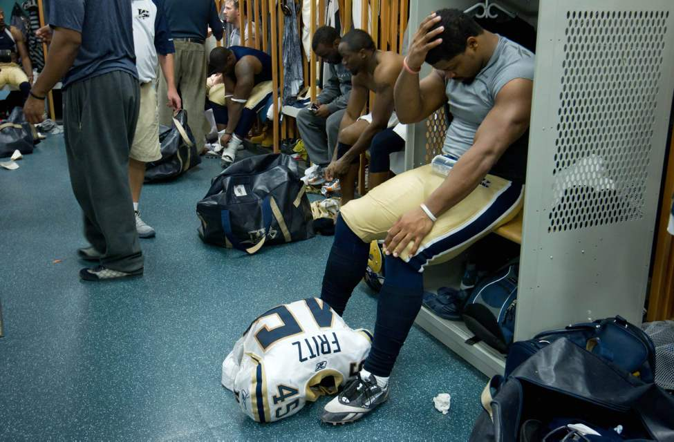 Winnipeg Blue Bombers' Rodney Fritz, right, sits in the dressing room after losing to the B.C. Lions. (THE CANADIAN PRESS/Darryl Dyck)