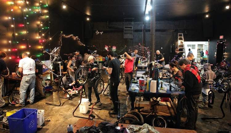 Dozens of mechanics have been working for the last twenty-four hours fixing up over 200 bicycles for Winnipeg children in need during the second annual Cycle of Giving event at the Atomic Centre on Logan Avenue. Mike Deal / Winnipeg Free Press