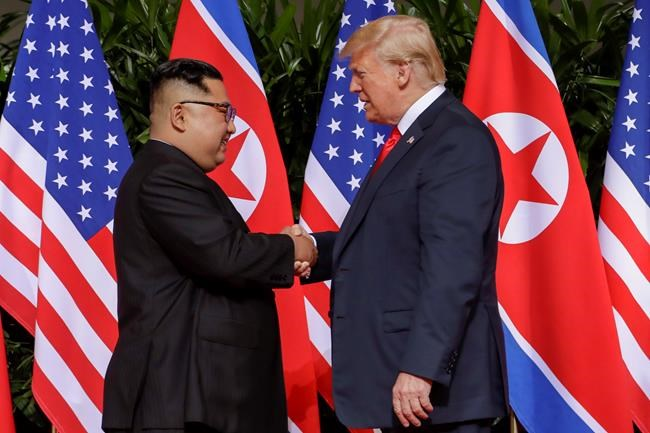 U.S. President Donald Trump shakes hands with North Korea leader Kim Jong Un on Tuesday in Singapore.  (Evan Vucci / The Associated Press)