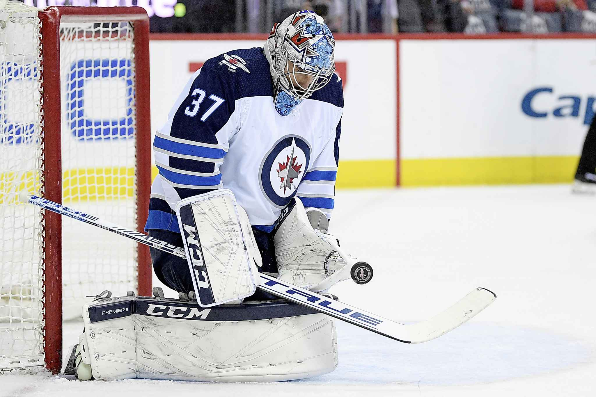 NICK WASS / THE ASSOCIATED PRESS</p><p>Winnipeg Jets goaltender Connor Hellebuyck (37) stops the puck during the first period of an NHL hockey game against the Washington Capitals, Sunday, March 10, 2019, in Washington.</p>