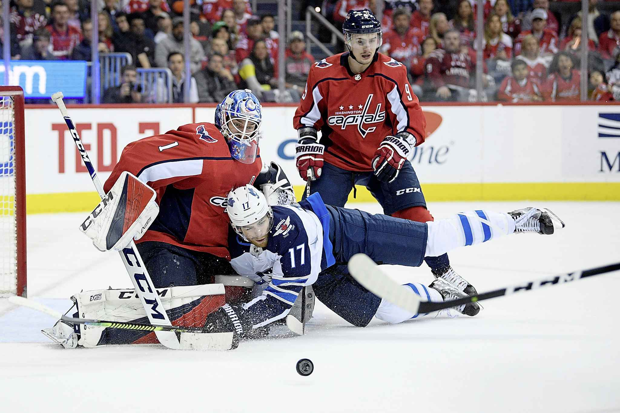 NICK WASS / THE ASSOCIATED PRESS</p><p>Winnipeg Jets center Adam Lowry (17) collides into Washington Capitals goaltender Pheonix Copley (1) during the second period of an NHL hockey game, Sunday, March 10, 2019, in Washington. Also seen is Capitals defenseman Dmitry Orlov (9), of Russia.</p>