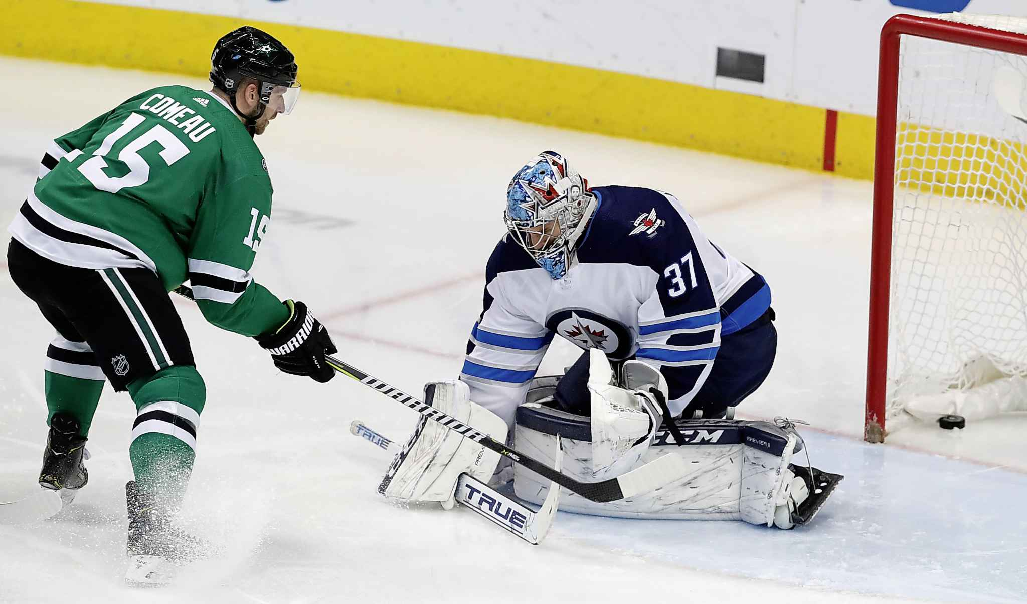 LM OTERO / THE ASSOCIATED PRESS</p><p>Dallas Stars left wing Blake Comeau (15) scores a goal against Winnipeg Jets goaltender Connor Hellebuyck (37) during the second period of an NHL hockey game in Dallas, Saturday, Jan. 19, 2019.</p>