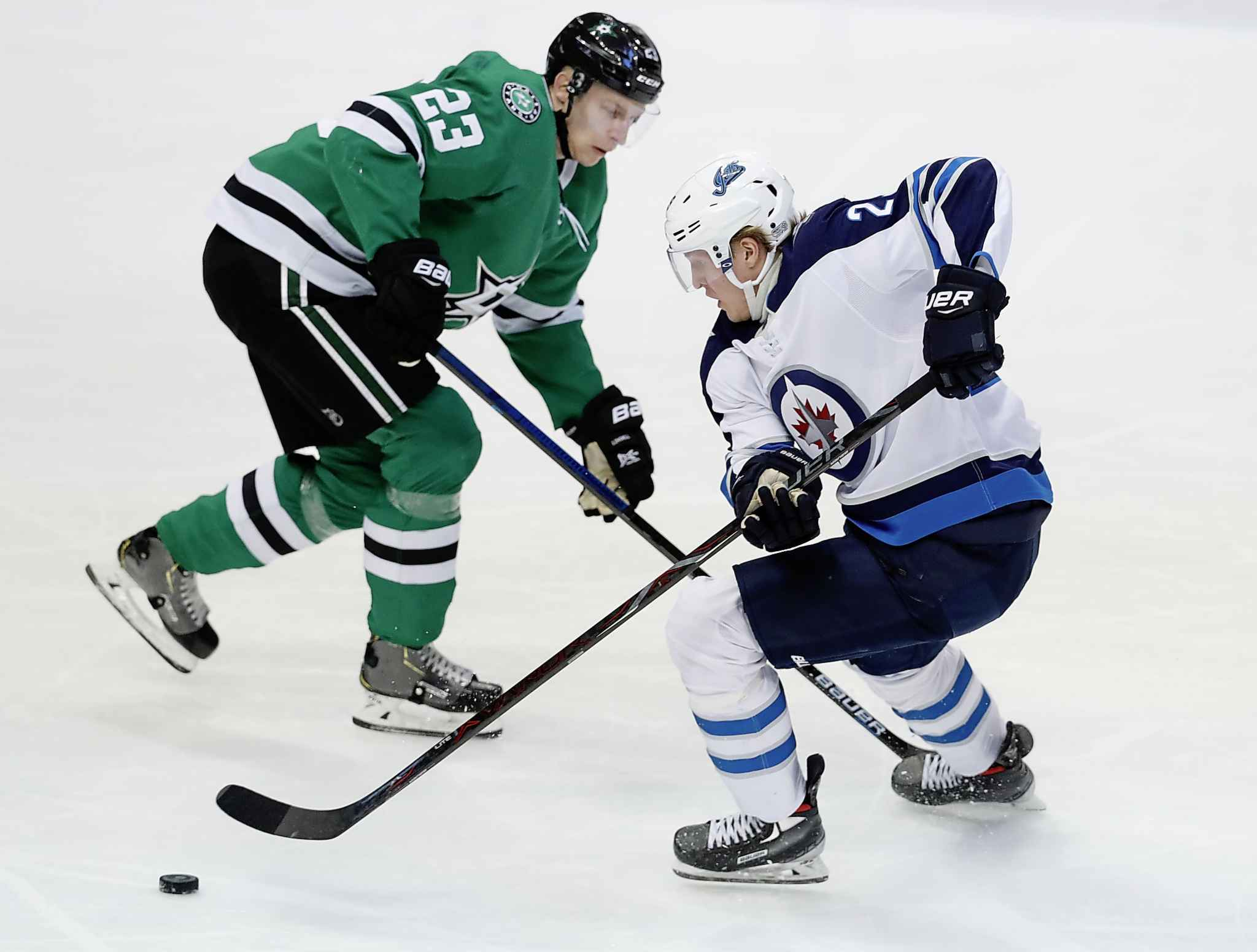 LM OTERO / THE ASSOCIATED PRESS</p><p>Winnipeg Jets right wing Patrik Laine (29) skates for the puck against Dallas Stars defenseman Esa Lindell (23) during the second period of an NHL hockey game in Dallas, Saturday, Jan. 19, 2019.</p>