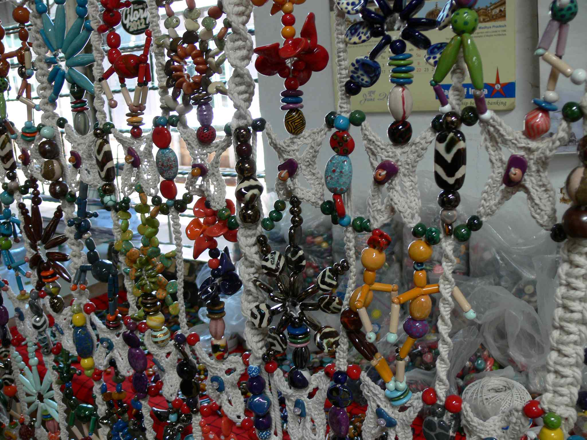 A wall hanging made of ceramic beads for sale in the Kazuri gift store.