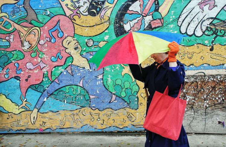 Ingrid tries to keep control of her colourful umbrella while strolling along King Street in the Exchange District of Winnipeg. Mike Deal / Winnipeg Free Press