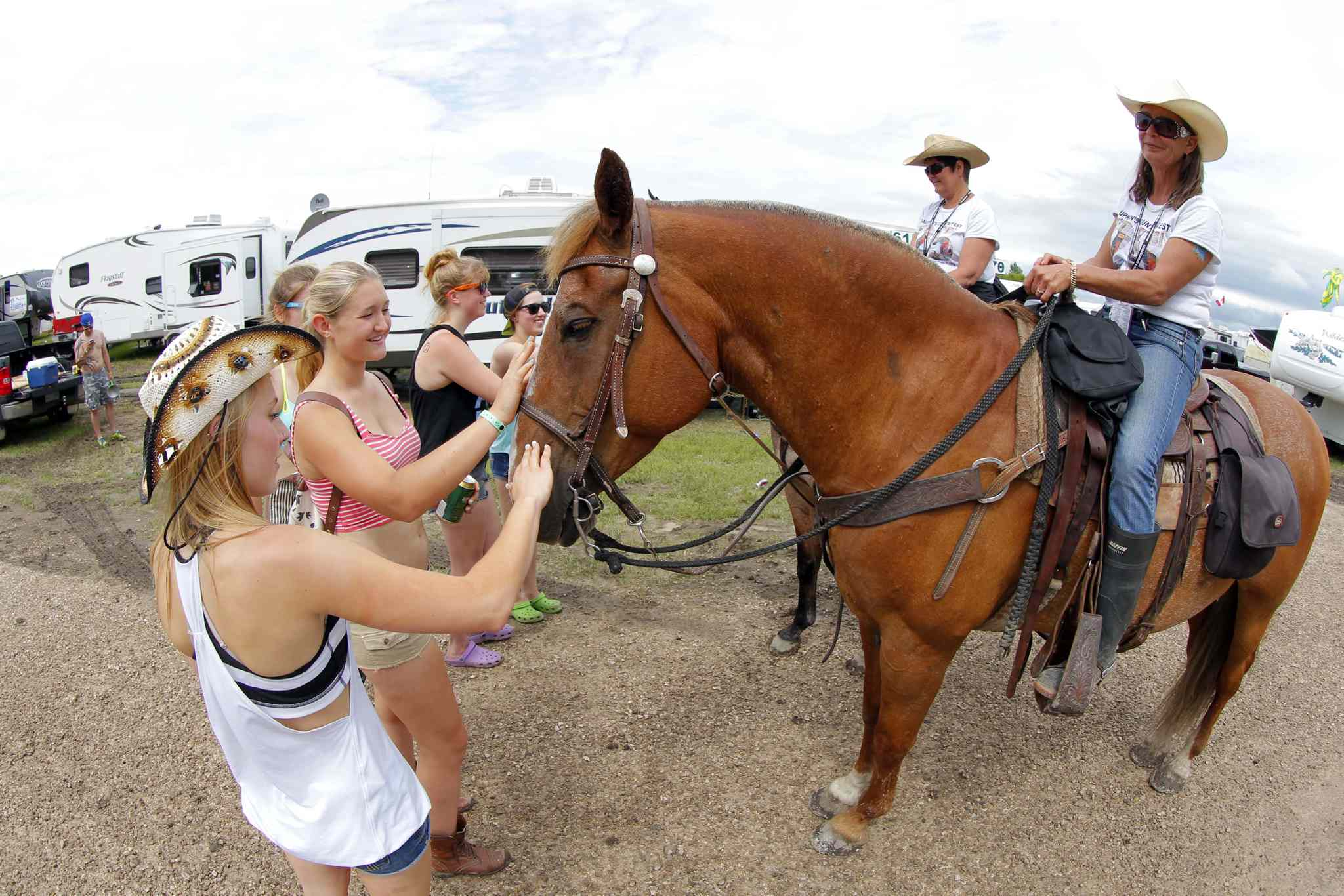 Some Countryfesters get introduced to Jeanie VanWorkum and her horse named Mister. They horse crew was brought in to promote good citizenship in the campground.