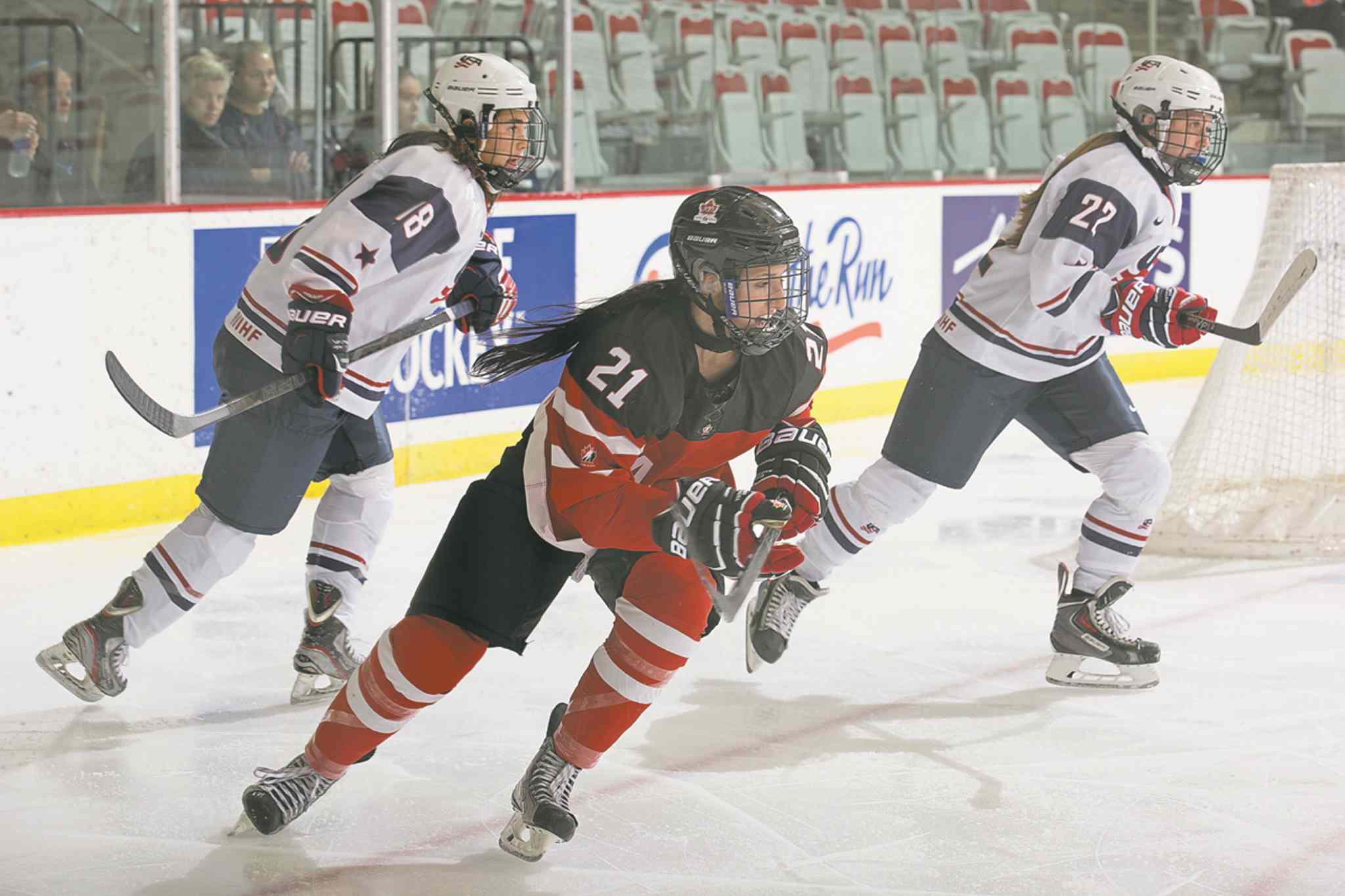 Higham, centre, played for Team Canada in a three-game series against the U.S. this summer. She returns to Team Canada to play in the IIHF U18 World Championship.