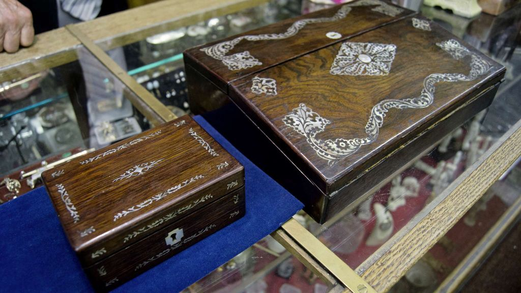 """What is the most unusual/rare piece in your shop? Many unusual items have come through the doors but this late 19th century salesman sample of a lap desk (left) and the full scale model rarely are seen together.  """"Salesman samples are collectible and they're quite rare. When I acquired this, even my father had never seen one before. It's oddly one of the rarer items.""""  (Danielle Da Silva - Sou'wester)"""