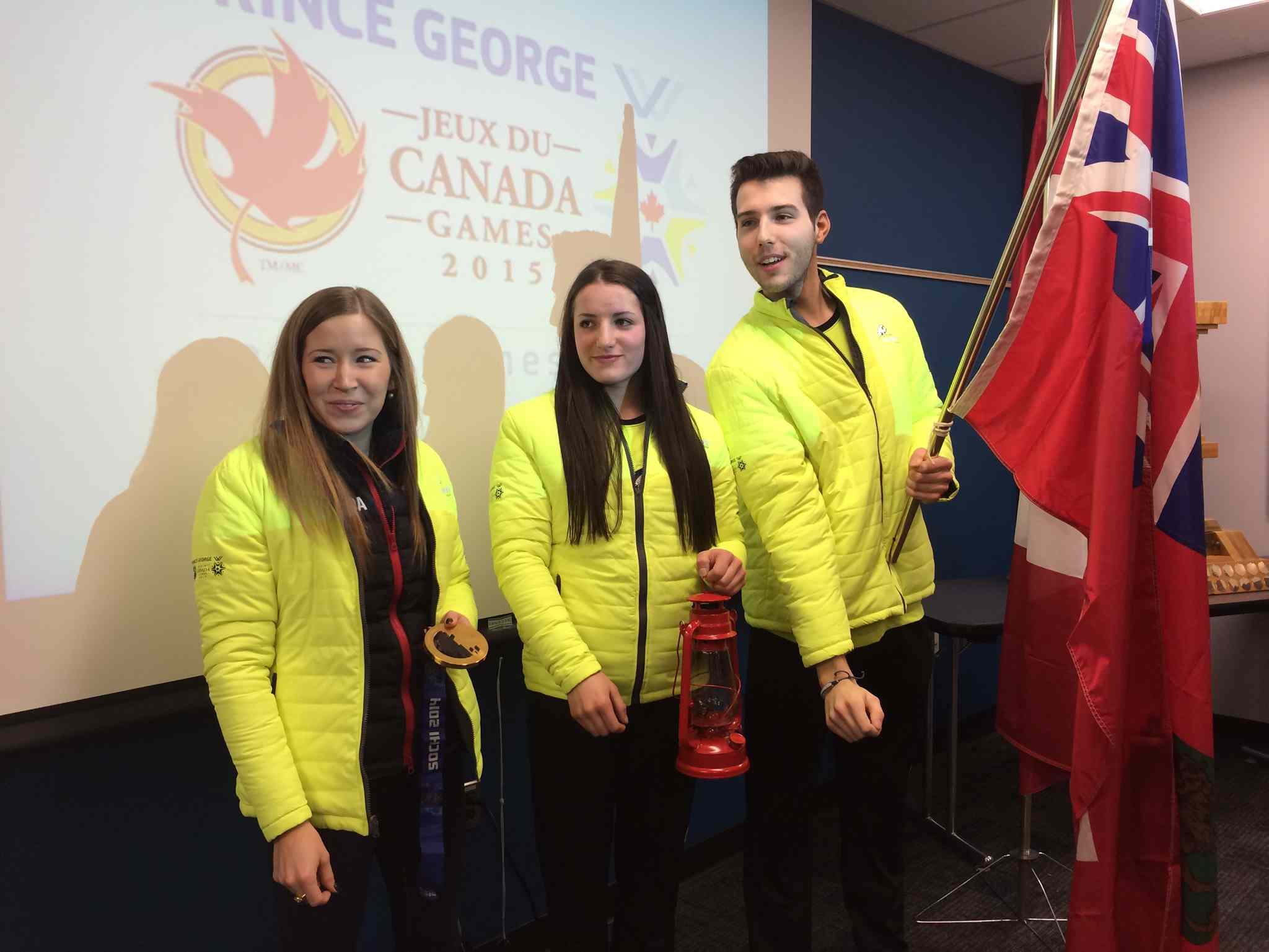 Archery competitor Keenan Brown, seen at a press conference prior to the Canada Winter Games with hockey player Christian Higham, centre, and honorary Manitoba captain Kaitlyn Lawes, left, earned Manitoba's first medal, a gold, in Prince George, B.C.
