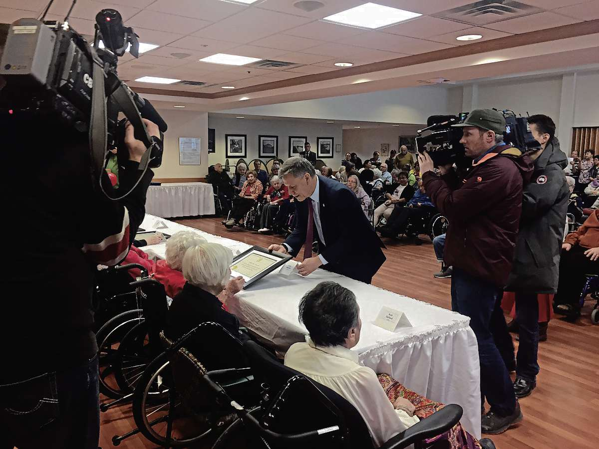 Winnipeg South MP Terry Duguid presents certificates to 11 centenarians on Jan. 23 at the Saul and Claribel Simkin Centre on behalf of Justin Trudeau.