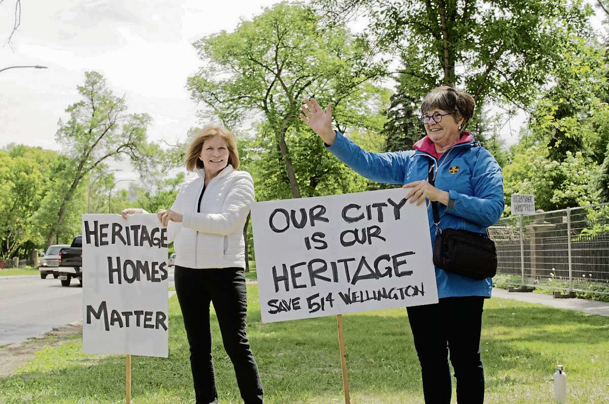 Mary Hall and Christine Skene demonstrate outside of 514 Wellington Cres. in Crescentwood. The stately mansion, over a century old, was threatened with demolition on June 6. The building was saved when the City of Winnipeg director of planning, property, and development nominated Crescentwood as a heritage conservation district, setting a potential two-year process in motion.