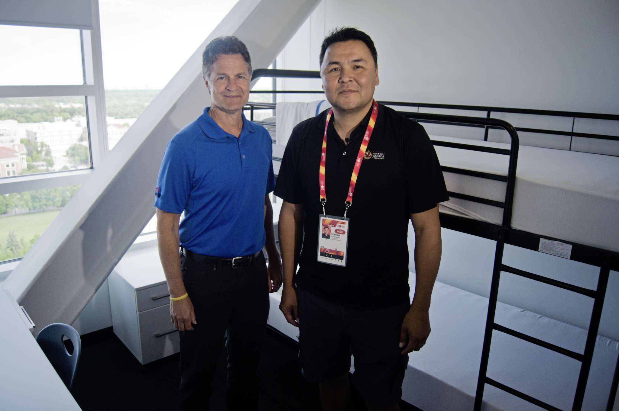 Jeff Hnatiuk, president and CEO of the 2017 Canada Summer Games, and Norman Ettawacappo, village and athletes services manager, pose for a photo in a dorm of the Athletes' Village, located in the Pembina Hall at the University of Manitoba's Fort Garry campus. Three student residences will host 2,000 athletes, coaches, and mission staff during the competition.
