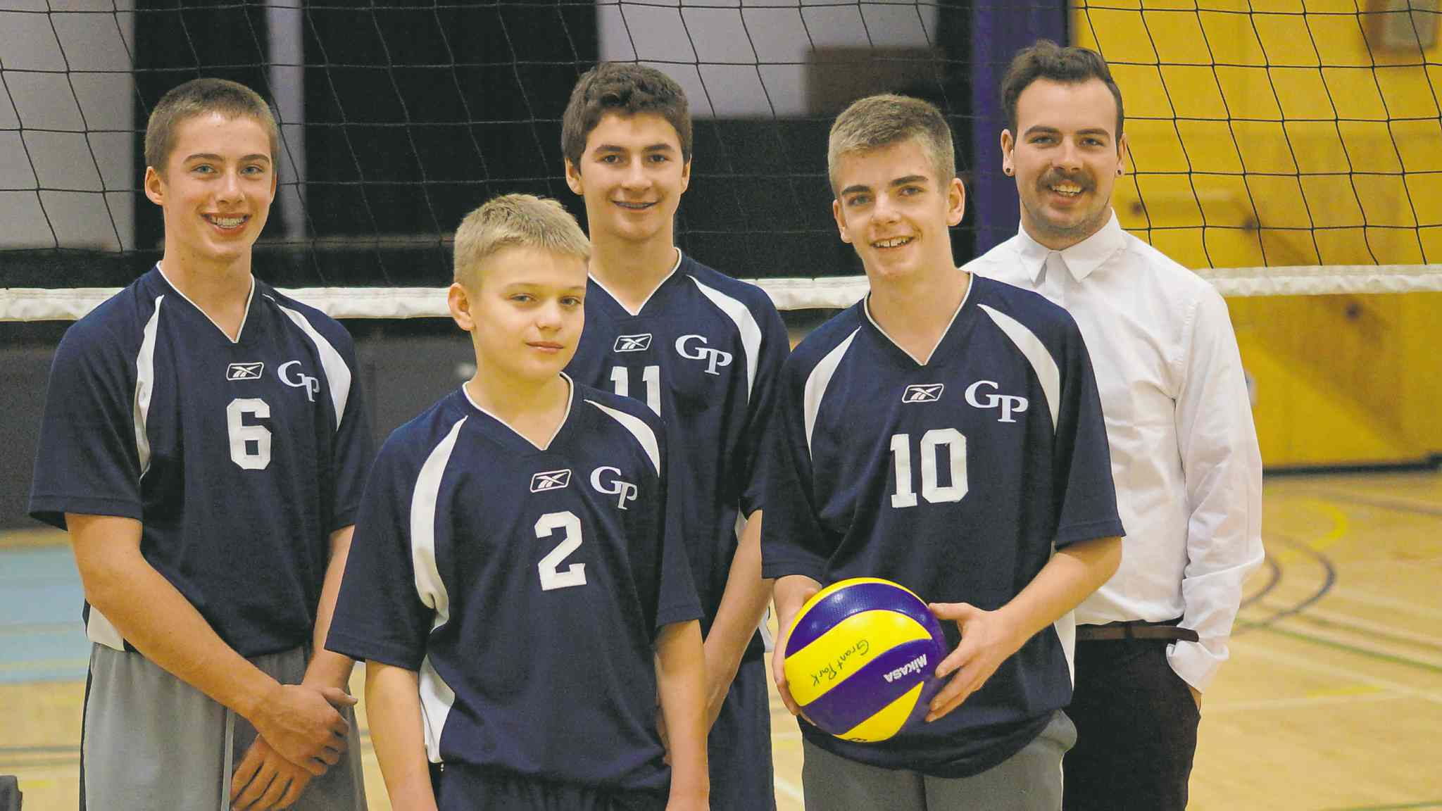 Nov. 26, 2014 - The Grade 9 boys' volleyball team at Grant Park are going to provincials next weekend. From left to right: Brent Broughton, Jake Weir-Cooper, Nick Cicek, Ben Van Bastelaere and coach Tanner Owens.. (DANIELLE DA SILVA/CANSTAR/SOUWESTER)