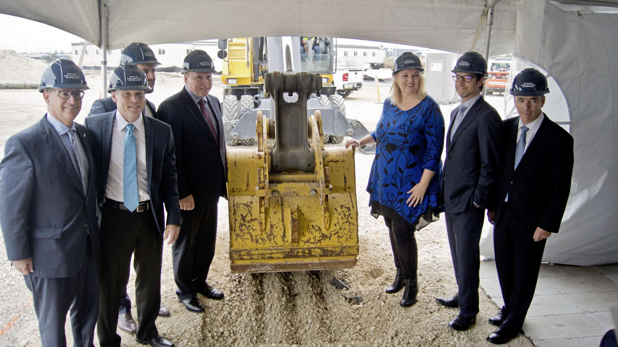 Representatives of Ivanhoé Cambridge, Forster Projects, and Harvard Developments, along with Coun. Marty Morantz and deputy premier Kerri Irvin-Ross break ground on the new Outlet Collection Winnipeg.