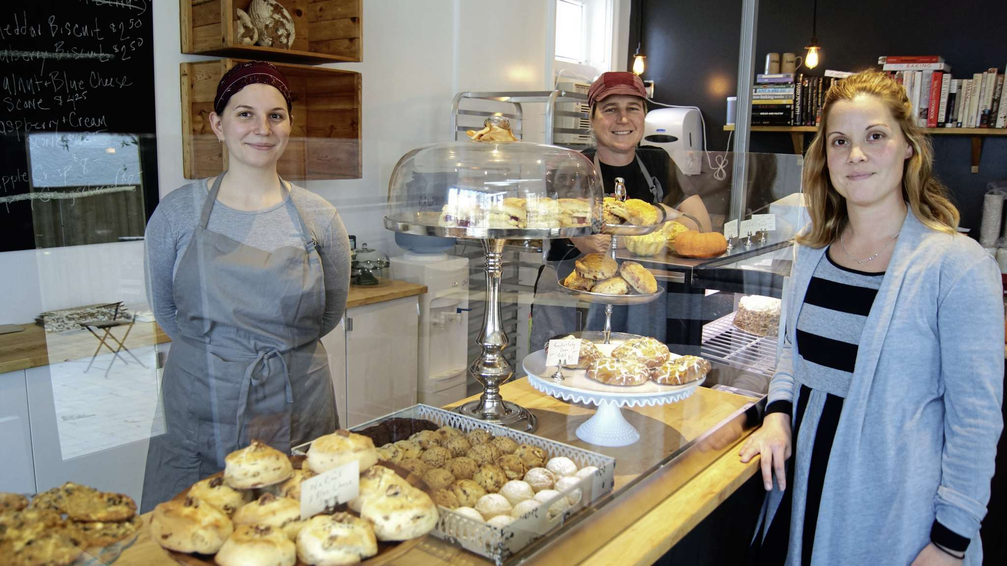 From left: Artemis Schroedter, front of house; Tammy Klos, wholesale manager; and Suzanne Gessler, the owner and founder of The Pennyloaf Bakery (858 Corydon Ave.).