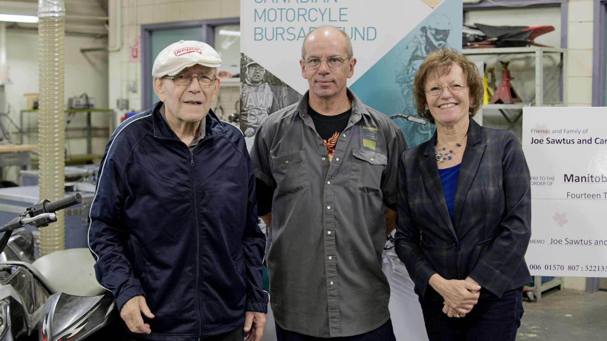 From left, Joe Sawtus, Geoff Ives, and Judy Mathieson in the Manitoba Institute of Trades and Technology's motorsport shop.