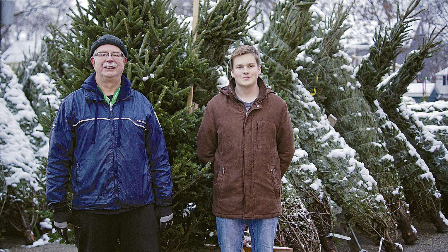 Tim McManus, a Beaver leader with the 67th Winnipeg Scout Group, and scout Jack Button are ready to help community members once again take home their perfect Christmas tree this season.