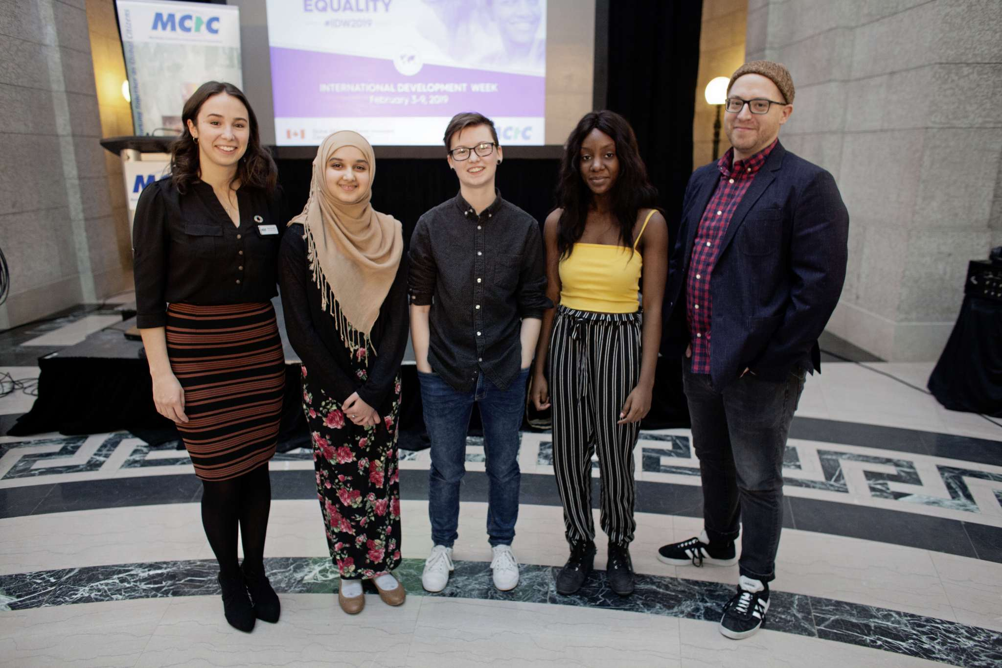 From left, Keana Rellinger, public engagement specialist with the Manitoba Council for International Cooperation; students Urooba Ahmed, Jay Webster, Sophia Abolore; and spoken word poetry project facilitator Steve Locke at the launch of International Development Week at the Legislature, where the group premiered their piece What We Teach.