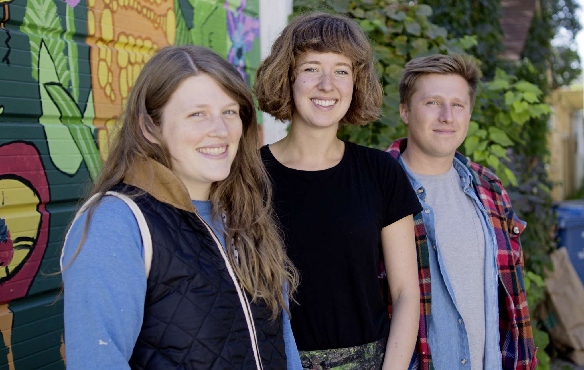 (From left) Hannah Doucet, Natalie Baird, and Toby Gillies will be creating a mural at Little Sister Coffee Maker as part of Synonym Art Consultation's Wall-to-Wall mural festival.
