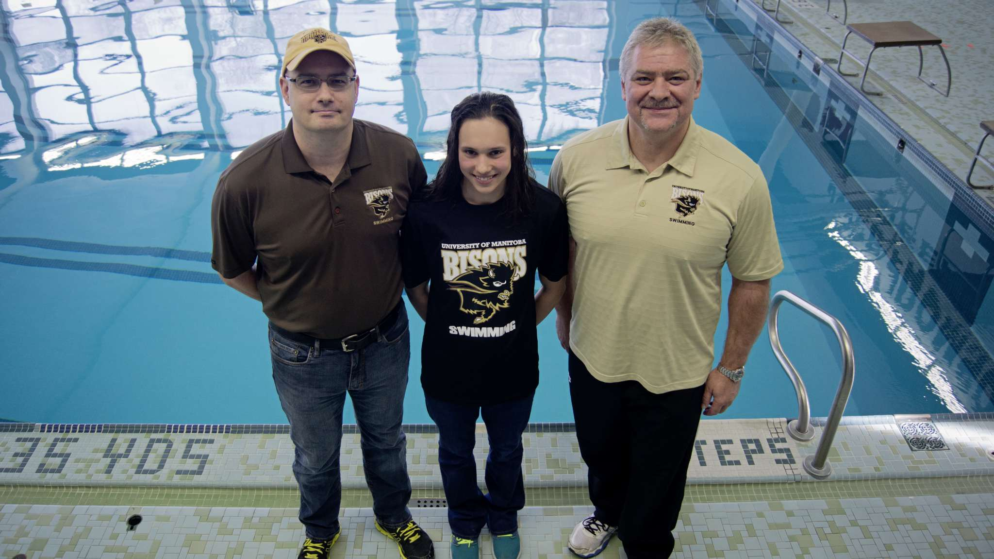 Kelsey Wog, centre, has committed to swim with the University of Manitoba Bisons in the 2016-2017 season. She is pictured with her coaches Craig McCormick, left, and Vlastimil Cerny.