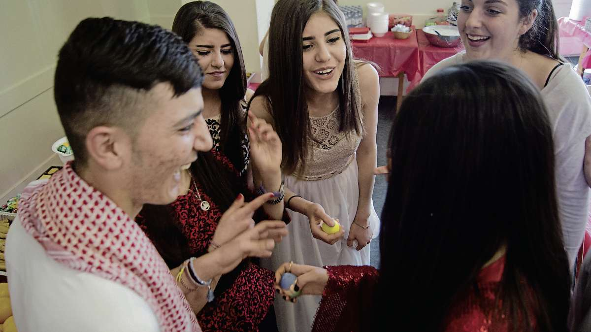 April 19, 2017 - Members of Winnipeg's Yazidi community celebrate the religious new year at the First Unitarian Universalist Church with a game featuring coloured, hard boiled eggs that are struck against one another.  (DANIELLE DA SIVLA/SOU'WESTER/CANSTAR).