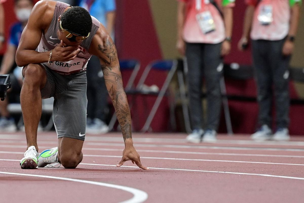 """Canadian Andre De Grasse, newly crowned Olympic champion in the 200 metres, let it all out after the race of a lifetime in Tokyo: """"I was crying a bit. I was just so happy and so proud of myself that I did it."""""""
