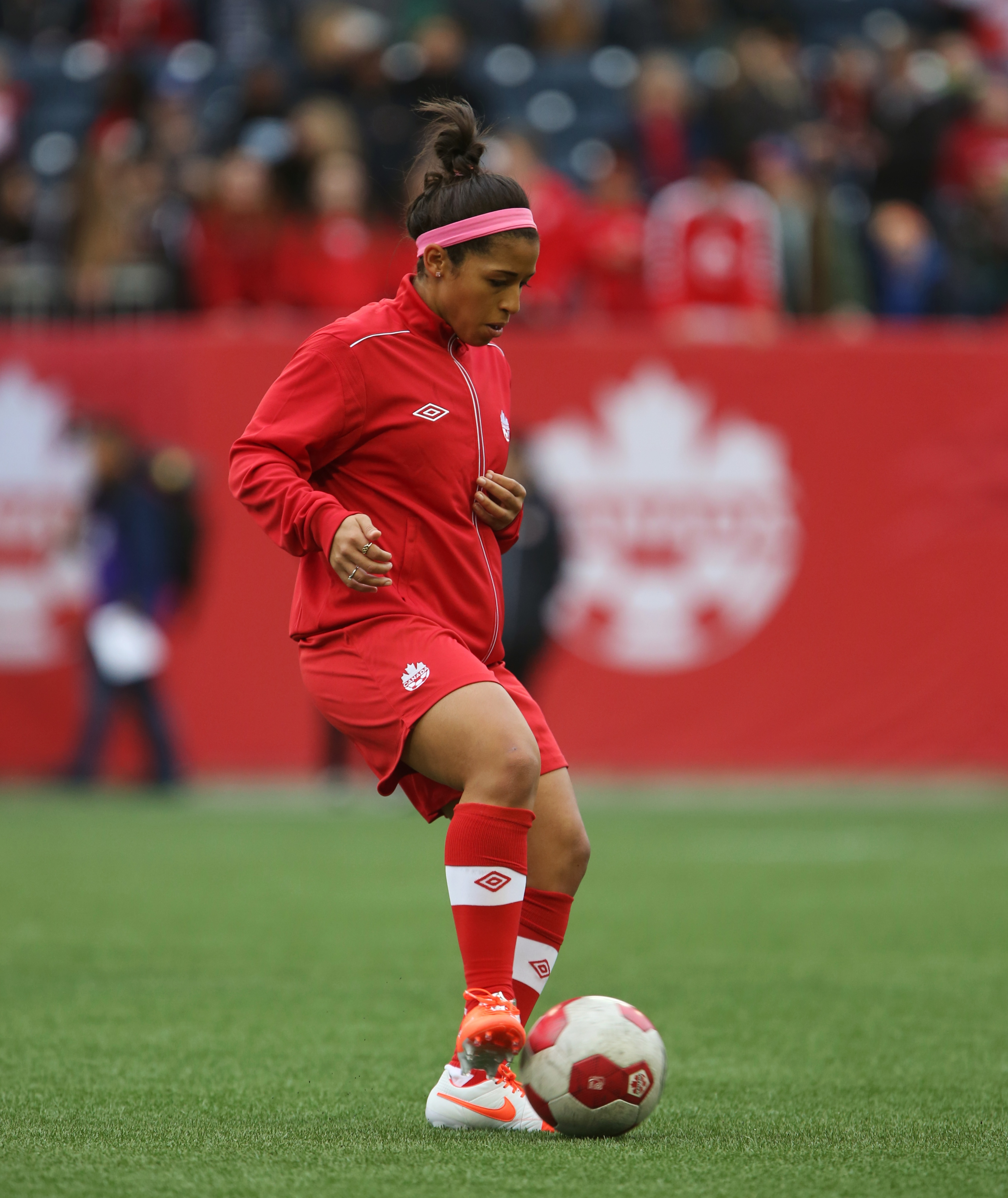Team Canada midfielder Desiree Scott warms up before the Canada vs USA soccer friendly in Winnipeg Thursday.