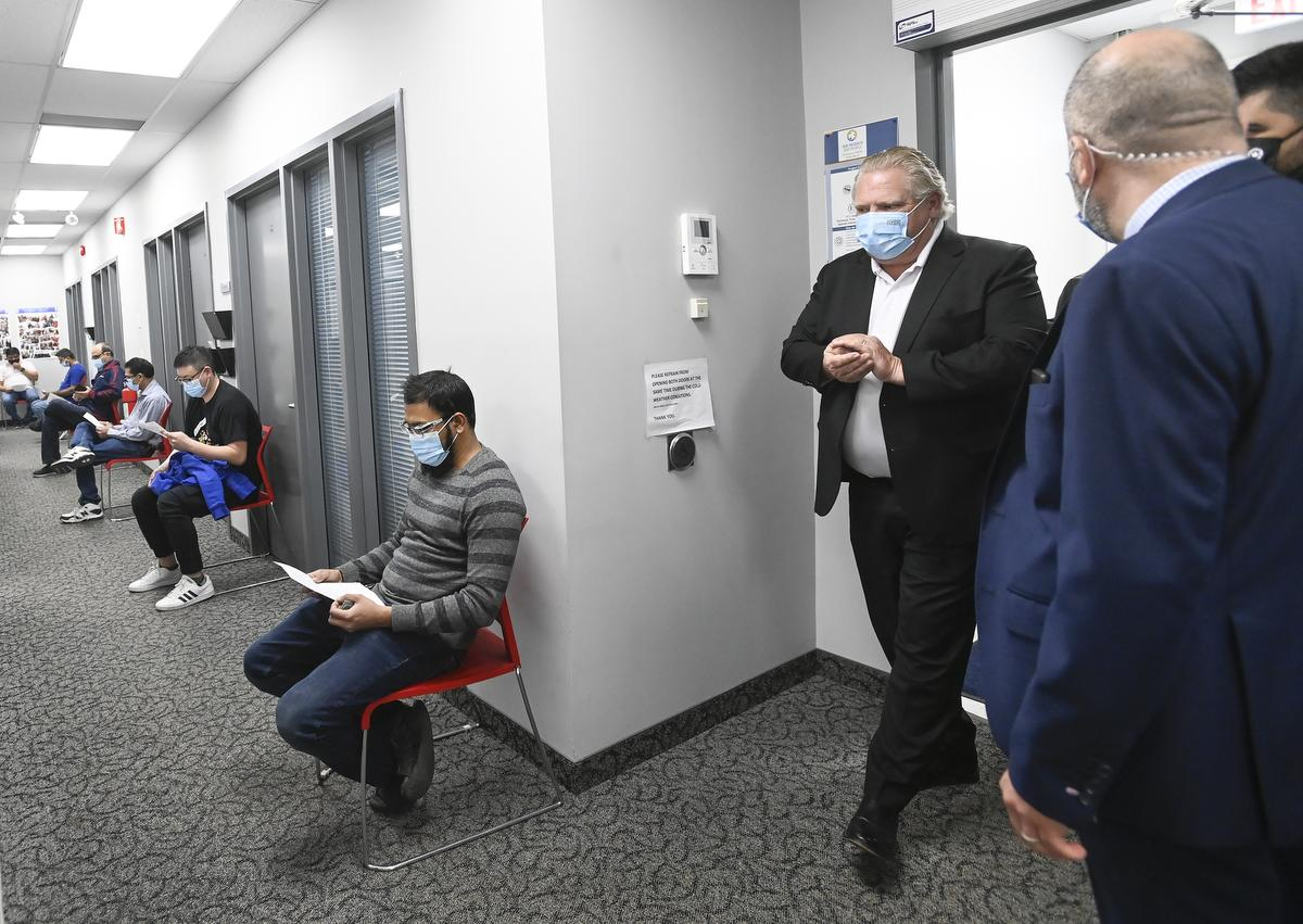 Premier Doug Ford visits frontline workers at Apotex as they are administered COVID-19 vaccinations through a mobile vaccination clinic in Toronto on April 9, 2021.
