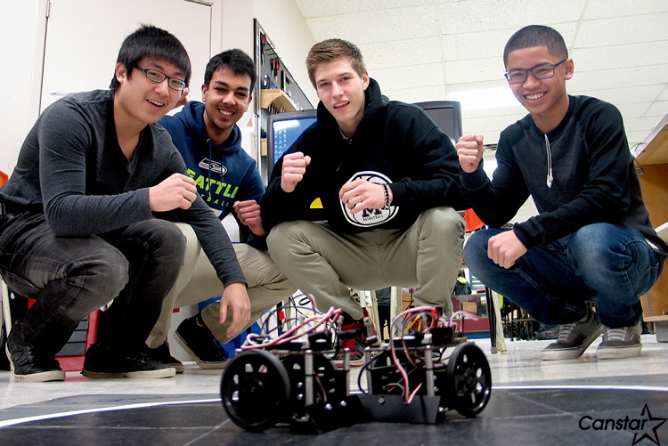 From left to right: Kenneth Zhong, Hardeep Dhillon, Mathew Dunning and Shauldon Santos cheer on a pair of battling sumo bots. Maples Collegiate's electronics department spent weeks building and programming the bots, which fought in an annual tournament Feb. 15.