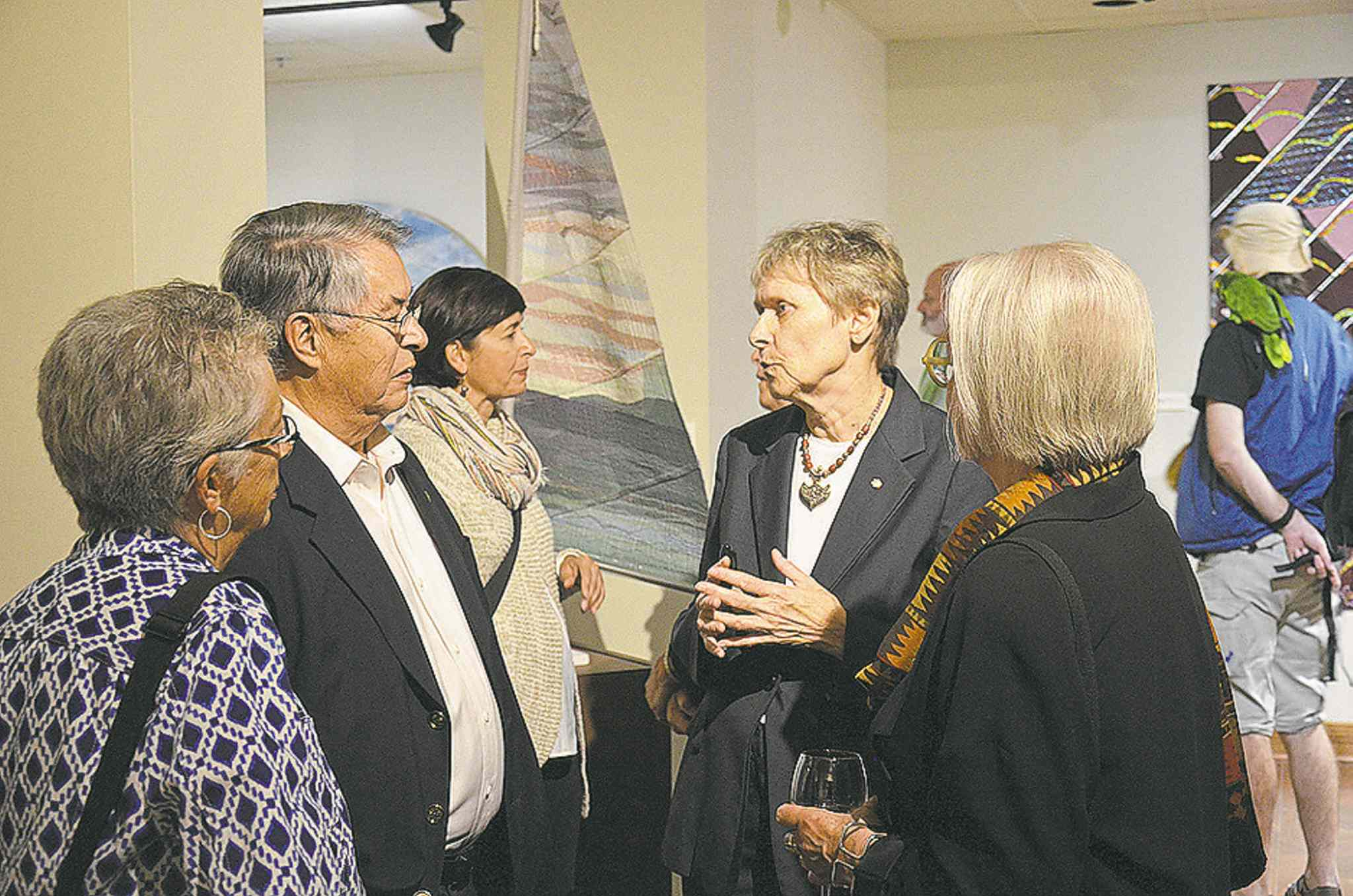 Roberta Bondar (second right) discusses her work at The Buhler Gallery in St. Boniface Hospital.