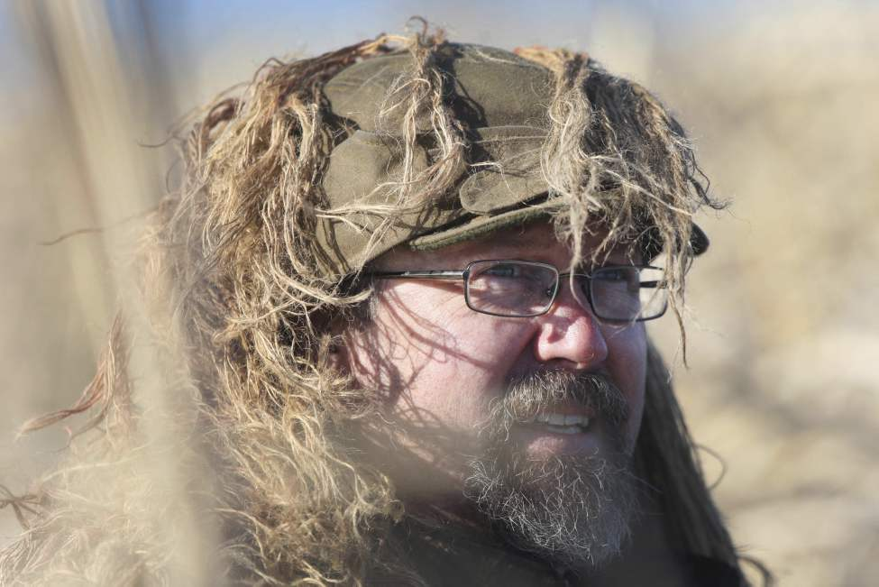 Fred Greenslade waits for ducks to commit to his decoys at Delta Marsh. (JOE BRYKSA / WINNIPEG FREE PRESS)