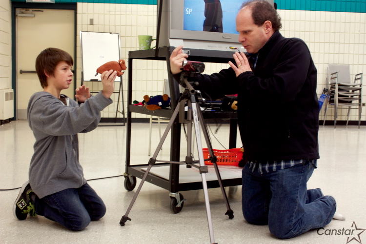 Filmmaker Randy Guest works with a student in Polson School's Grade 6Z class as part of the Artists in the Schools program.