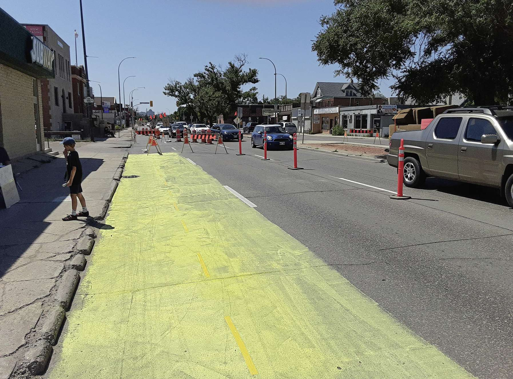 A temporary bike lane on northbound Henderson Highway would allow cyclists to feel safe enough to stay off sidewalks, according to area business owner Michel Durand-Wood.