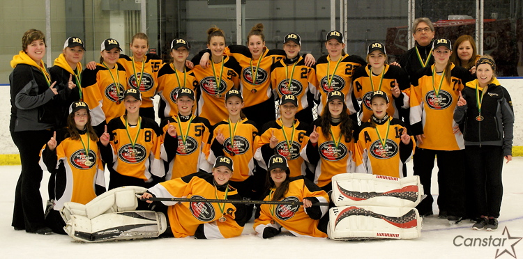 Team Manitoba celebrates its Under-14 Western Canadian Ringette Championship after an undefeated tournament.