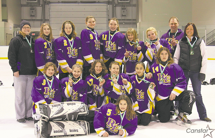 The River East Kaos U14 Tween A ringette teams poses with gold medals won at a January tournament in Regina.