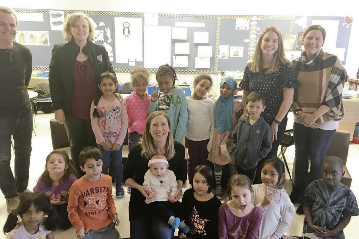 """Sarah Allum's Grade One Class at General Byng School participate in the Roots of Empathy Program with Mom Jenna and """"Baby Teacher"""" Summer."""""""