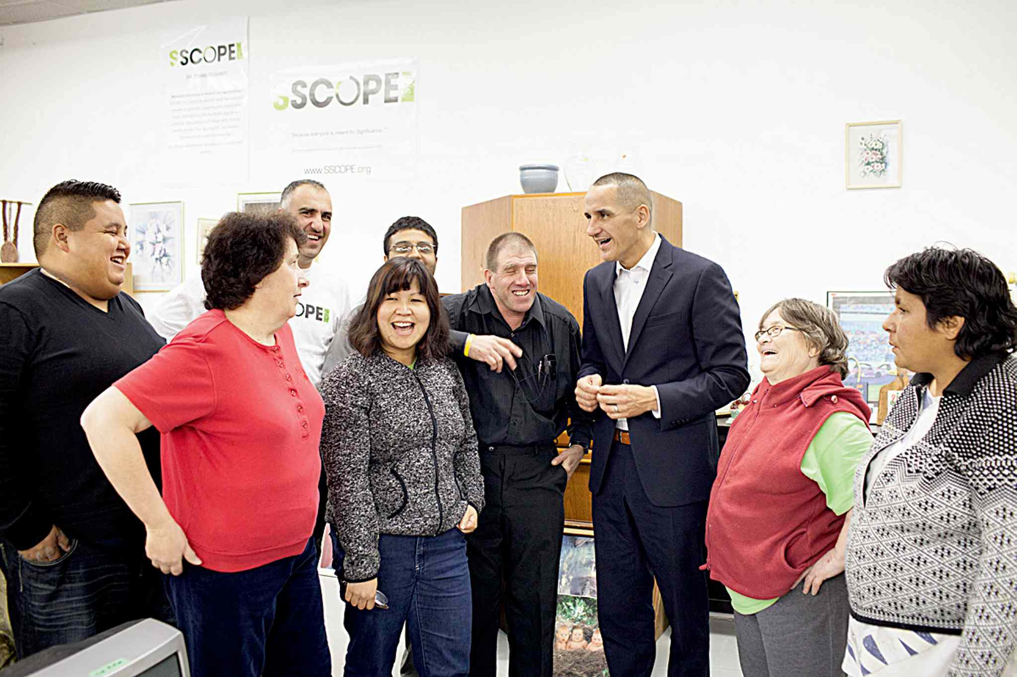 In celebration of Disability Employment Awareness Month, Kevin Chief, MLA for Point Douglas, visits with staff and members of SSCOPE. Pictured with Chief, from left: executive director Dan Ingalls, Tanya Arcioni, Nezar Abdulahad, Van Nong, Jugminder Hans, Sean Keenahan, Judy Ransome and Nancy Vermette.