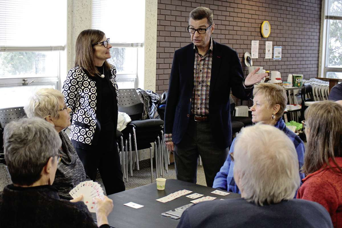 MP Doug Eyolfson and Filomena Tassi, Minister of Seniors, chat with patrons at the Charleswood 55-plus Active Living Centre on Nov. 12.