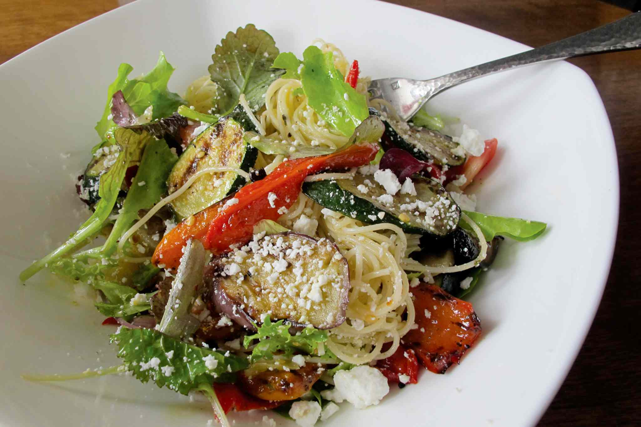 Mise is one of the many restaurants participating in Dine About Winnipeg. Pictured: the restaurant's angel hair pasta with grilled vegetables, concasse tomatoes, Kalamata olives, feta cheese, pickled eggplant, wilted greens and artichoke hearts, (which may not necessarily be among the dishes offered).