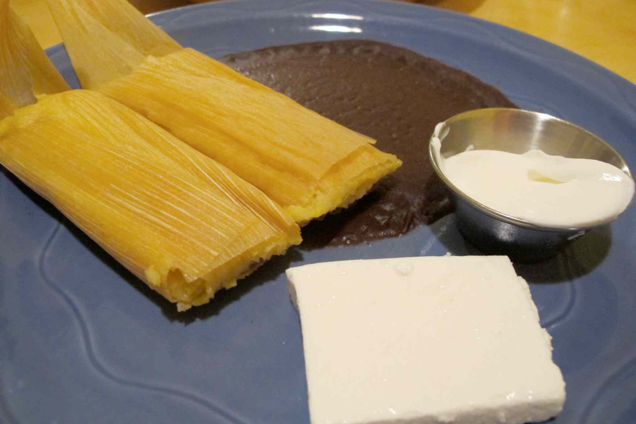 La Fiesta Cafecito's tamales (pictured), contain a steamed-cornbread-like filling that's just one of the many wonderful flavours on offer at the restaurant, which specializes in Salvadoran cuisine.