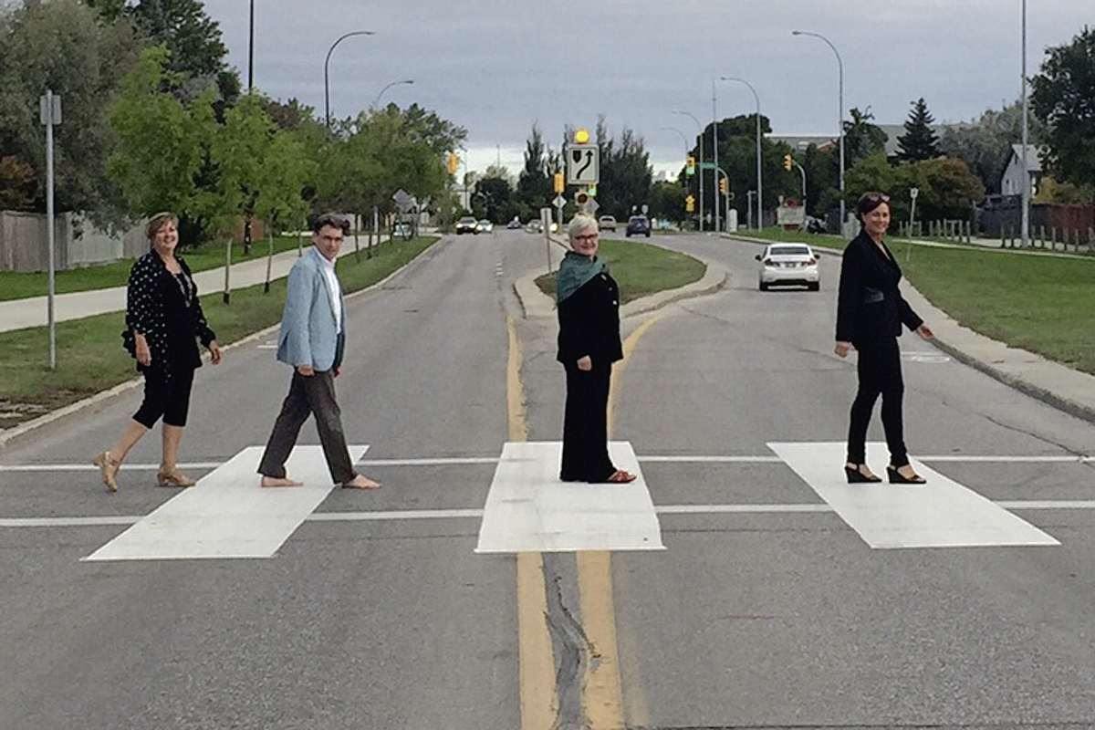 From left: Winnipeg South Coun. Janice Lukes, St. Vital Coun. Brian Mayes, Riel MLA Christine Melnick and Seine River MLA Theresa Oswald pay homage to the Fab Four at the new crosswalk at the intersection of Dakota Street and the South St. Vital Trail.