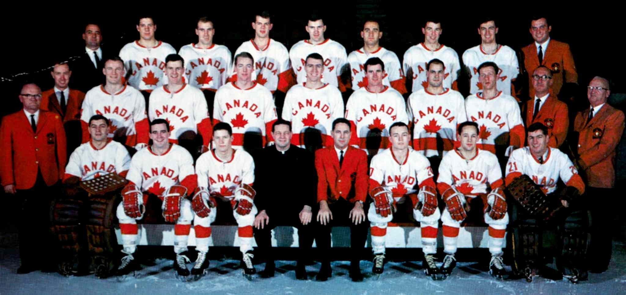Canada's Olympic hockey team 1967-68 (l-r): Front row, Ken Broderick, Gary Dineen, Gerry Pinder, Father David Bauer (special advisor), Jack McLeod (coach and general manager), Morris Mott, Fran Huck, Wayne Stephenson. Middle row, Scotty Clark (trainer), Ken Esdale (assistant trainer), Barry MacKenzie, Terry O'Malley, Danny O'Shea, Brian Glennie, Steve Monteith, Ted Hargreaves, Jean Cusson, Dr. Reid Taylor, Dr. Jack Waugh (team doctors). Back row, Bud Holohan (education advisor), Herb Pinder, Marshall Johnston, Brian Harper, Gary Begg, Ray Cadieux, Billy MacMillan, Paul Conlin, Phil Reimer (publicity director).