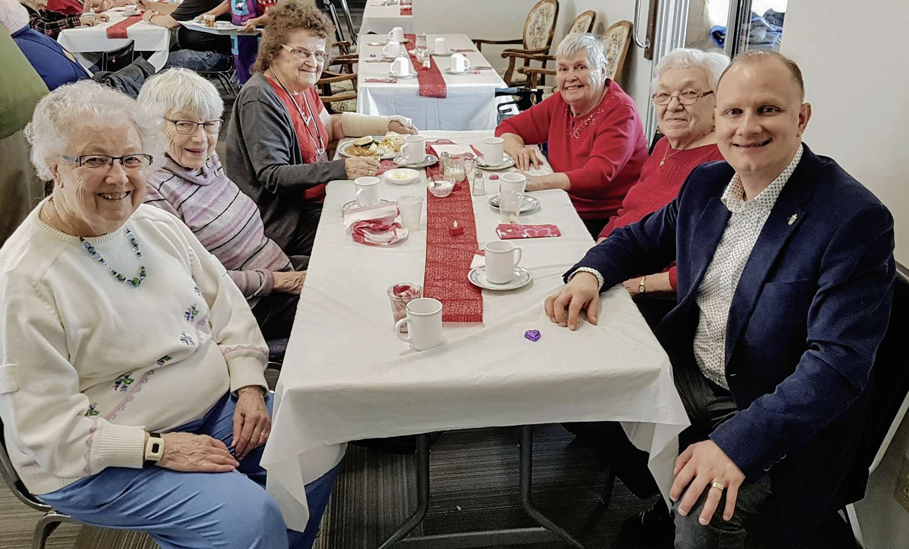 (From left) Helen Hopko, Evelyn Kohut, Sheila Daly, Irene Gaylord, Emily McDougal and Rossmere MLA Andrew Micklefield chatted at a Valentine's Day lunch.