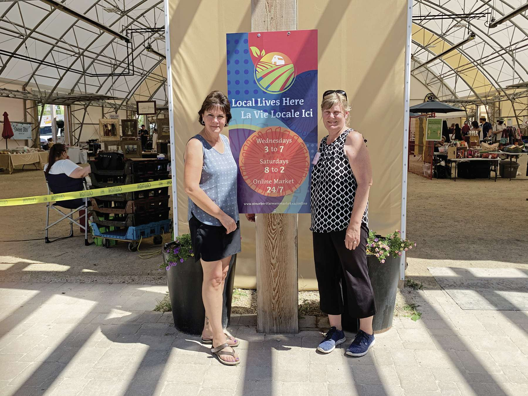 Seine River MLA Janice Morley-Lecomte (left) got the lowdown on how the St. Norbert Farmers' Market has adjusted to the COVID-19 pandemic from executive director Marilyn Firth.