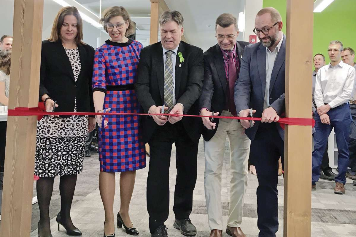 (From left) Heather Stefanson, MLA for Tuxedo; Cheryl Pauls, president of Canadian Mennonite University; Ian Wishart, Minister of Education and Training; Doug Eyolfson, MP for Charleswood-St. James-Assiniboia-Headingley; and James Magnus-Johnston, Director of the CMU Centre for Resilience cut the ribbon on the CMU's new Centre of Resilience.