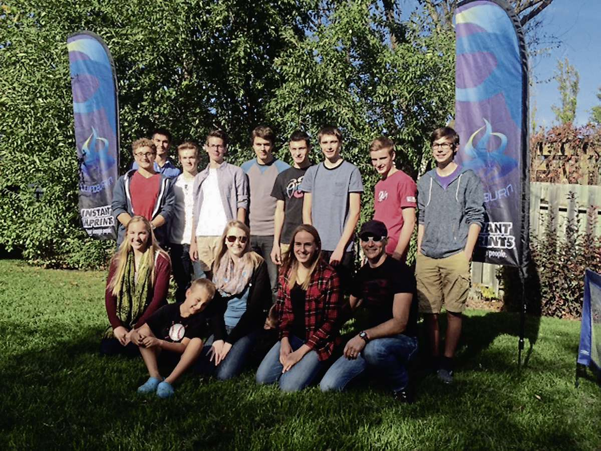 Members of the Windburn Race Team are pictured here with head coach Dave Lipchen (bottom right).