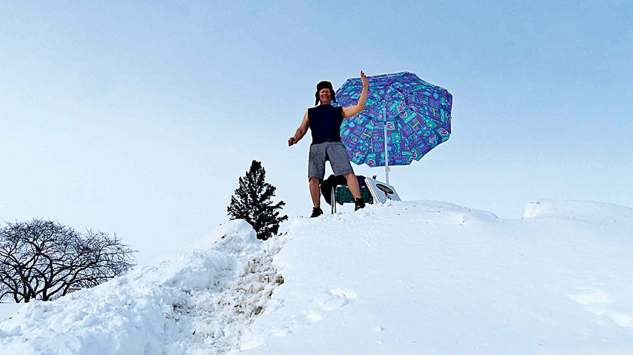 Norm Grywinski used a remote to take this photo of himself enjoying the first warm weekend of spring atop the snow hill in his front yard.